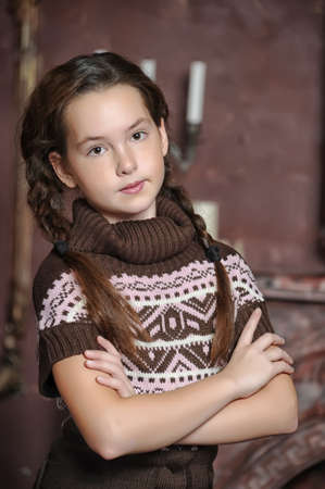 portrait of teen girl in a knitted sweater photo