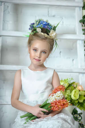 stare: portrait of the girl in a Victorian style with flowers in their hands Stock Photo