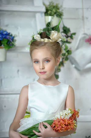 portrait of the girl in a Victorian style with flowers in their hands photo