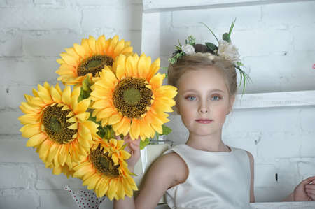 Girl with sunflowers photo