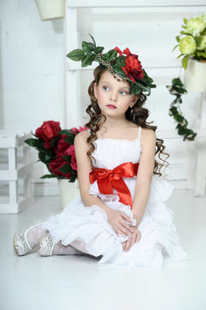 fancy dress: Vintage Girl with Flowers in her hair Stock Photo