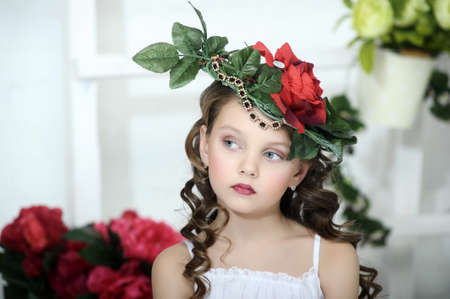 blonde blue eyes: Vintage Girl with Flowers in her hair Stock Photo