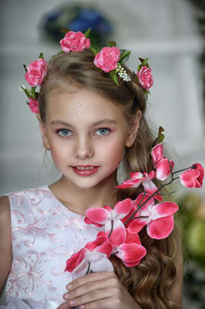 Vintage Girl with Flowers Stock Photo - 17458360