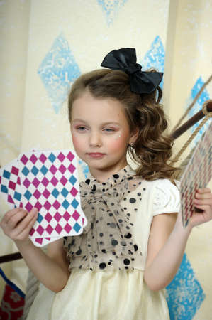 Litle young girl circus with playing cards photo
