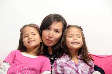 alike: Mom and girl twins Stock Photo