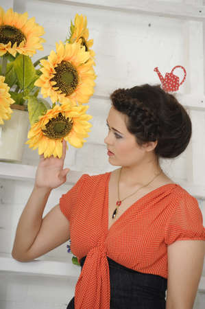 portrait of a young woman next to sunflowers Stock Photo - 17317695