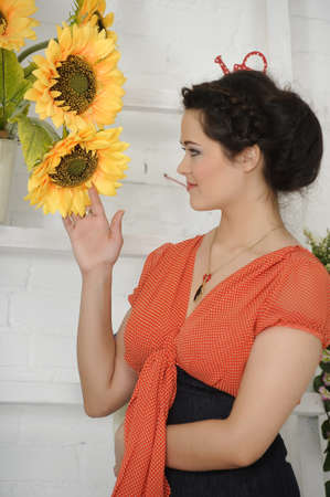 portrait of a young woman next to sunflowers Stock Photo - 17317692