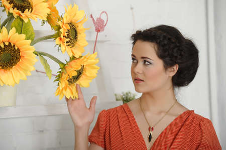 beautiful young brunette sunflowers Stock Photo - 17458329