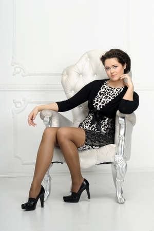 lovely businesswoman: Young woman in a chair