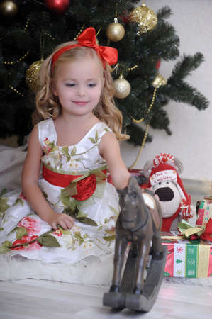 cute little girl in front of a Christmas tree  photo