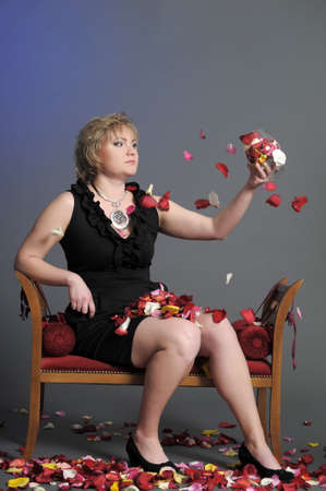woman and petals of roses photo
