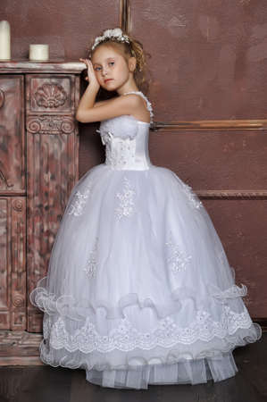The little girl in a dress of the bride Stock Photo - 17330985
