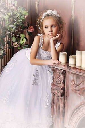 The little girl in a dress of the bride Stock Photo - 17330976
