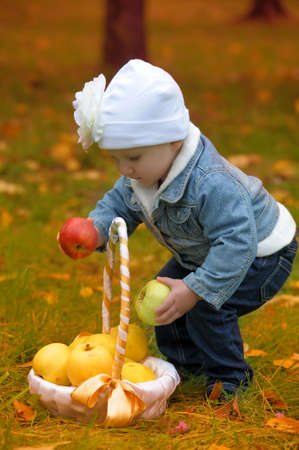The little girl with apples  photo