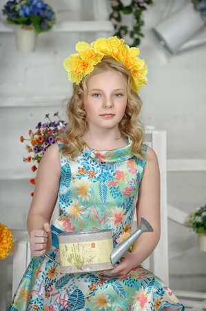Girl with  yellow flowers on her head photo