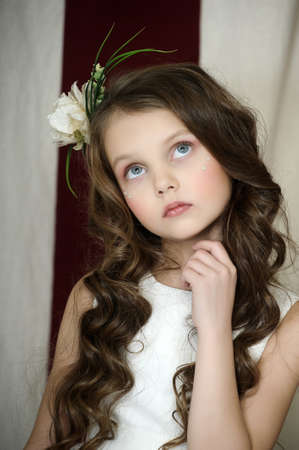 portrait of a beautiful girl with curly hair and a flower in her hair Stock Photo - 18594583