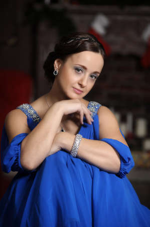 elegant woman in retro style in a blue dress photo