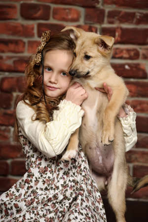 minature: girl with  puppy hugs