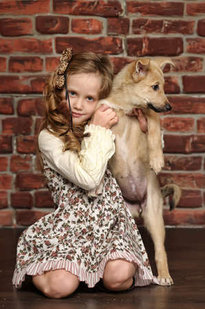 girl with  puppy hugs Stock Photo - 18997449