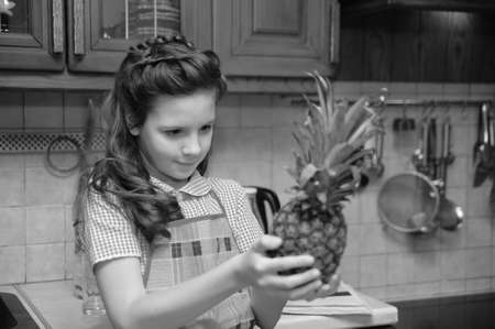 Girl with a pineapple in his hands Stock Photo - 17362077