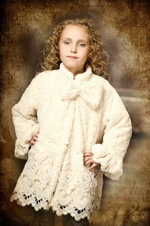girl in a stylish coat of artificial fur photo