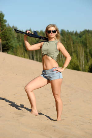 Woman with rifle Stock Photo - 17362385