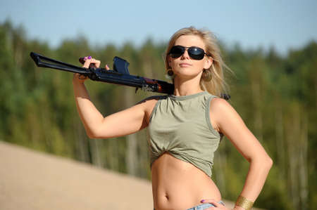 Woman with rifle Stock Photo - 17362389