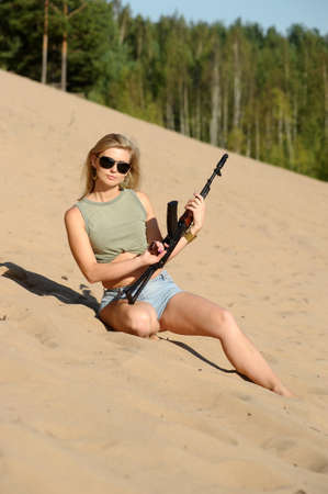 Woman with rifle Stock Photo - 17362386