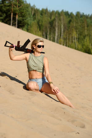 Woman with rifle Stock Photo - 17362387