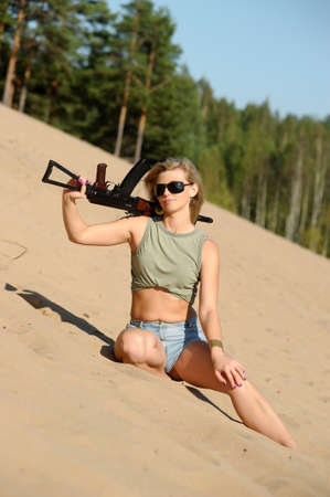 Woman with rifle Stock Photo - 17357580