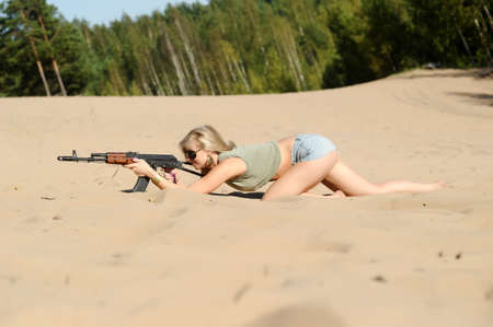 Woman with rifle Stock Photo - 17362384