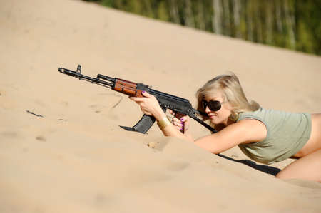 Woman with rifle Stock Photo - 17370982