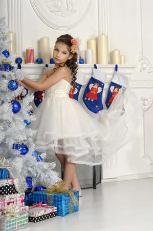 girl near the Christmas tree photo