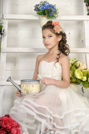 floriculturist: girl with a watering can Stock Photo
