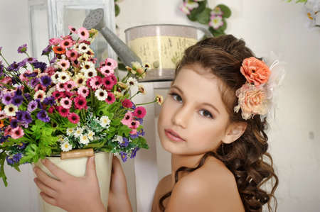 girl and a pot of flowers Stock Photo - 17968777