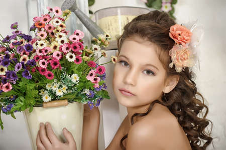 girl and a pot of flowers photo
