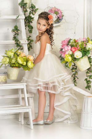 girl in white dress among the flowers Stock Photo - 18041979