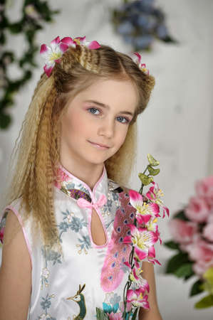 girl with pink flowers in her hair Stock Photo - 19023736