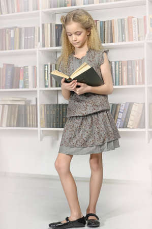 girl with a book in a library photo