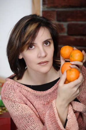 young woman with tangerines photo
