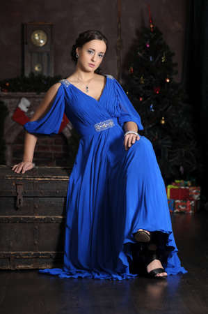 petite woman with blue dress photo