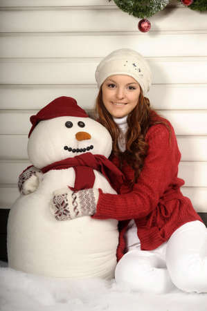 Woman with a snowman Stock Photo - 19024873