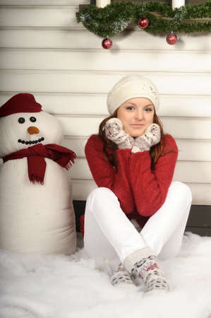 Woman with a snowman photo