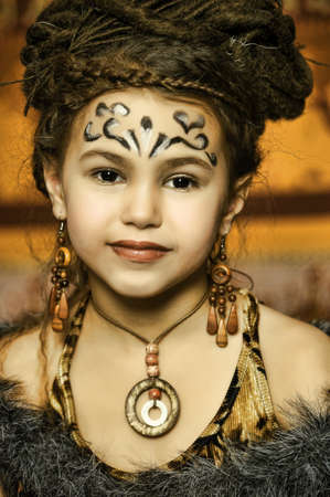 Girl with dreadlocks and clothing ethnic style photo