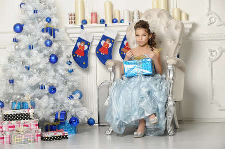 year 's: girl with gifts near a Christmas tree Stock Photo