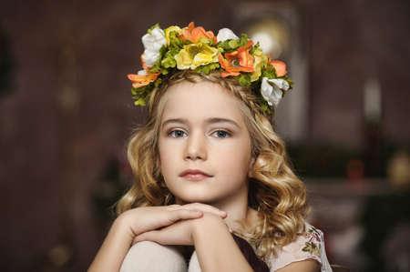 enjoymant: portrait of a girl with a wreath of flowers studio