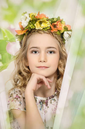 portrait of a girl with a wreath of flowers studio photo