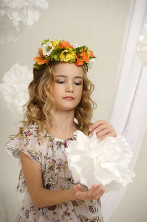 portrait of a girl with a wreath of flowers studio Stock Photo - 17532625