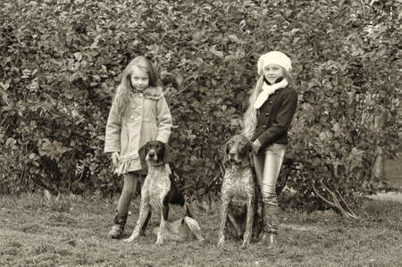 cute young farm girl: Two girls on a walk with the dogs