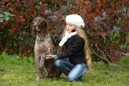 girl with a dog in the park Stock Photo - 17589842